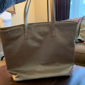 Handbags - Gold faux leather tote. Shoulder straps. Lined.